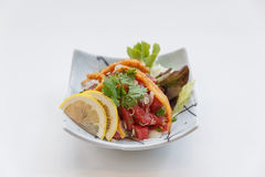 Raw Maguro Bluefin Tuna Spicy Salad Topping with Shirauo Japanese anchovy Tempura.  Stock Photography
