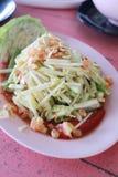 Raw mango salad in white dish. Stock Images