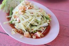 Raw mango salad in white dish. Royalty Free Stock Images