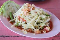 Raw mango salad in white dish. Stock Image
