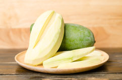 Raw mango. On wooden plate Stock Photography