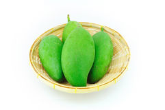 Raw Mangoes on Basket. Isolated and White Background Royalty Free Stock Photos