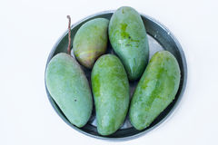 The raw mangoes on the plate Royalty Free Stock Photography