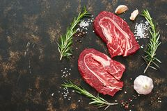 Raw marbled beef meat with spices close-up. A fresh top of the beef. A view from above, a copy of the space. royalty free stock photos
