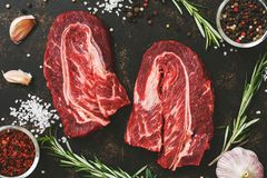 Raw marbled beef meat with spices close-up. View from above Royalty Free Stock Images