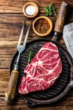 Raw marbled beef steak on grill pan. Top view Royalty Free Stock Photography