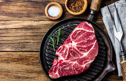 Raw marbled beef steak on grill pan. Top view Stock Photo