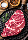 Raw marbled beef steak on grill pan. Top view Royalty Free Stock Images