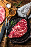 Raw marbled beef steak on grill pan. Top view Royalty Free Stock Photo