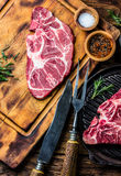 Raw marbled beef steaks on wooden cutting board. Top view Royalty Free Stock Photos