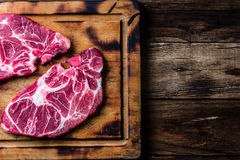 Raw marbled beef steaks on wooden cutting board. Top view Stock Photos