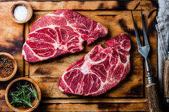 Raw marbled beef steaks on wooden cutting board. Top view Stock Photography