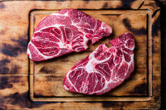 Raw marbled beef steaks on wooden cutting board. Top view Stock Image