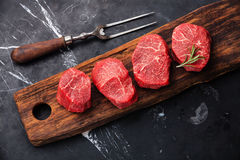 Raw marbled meat Steak filet mignon and meat fork stock photos