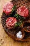 Raw marbled meat Steak filet mignon and seasonings. Raw fresh marbled meat Steak filet mignon and seasonings on wooden background Royalty Free Stock Images