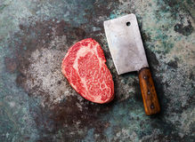 Raw marbled meat Steak Ribeye and butcher cleaver Royalty Free Stock Images