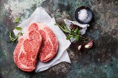 Raw marbled meat Steak Ribeye and seasonings Stock Image