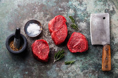 Raw marbled meat Steak, seasonings and meat cleaver. Raw fresh marbled meat Steak, seasonings and meat cleaver on metal background stock photography