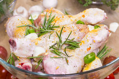 Raw marinated chicken with fresh vegetables Stock Photography