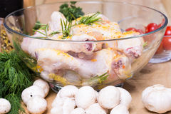 Raw marinated chicken with fresh vegetables Stock Photos