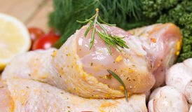 Raw marinated chicken with fresh vegetables Stock Photo