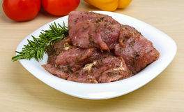 Raw marinated meat for bbq. With herbs and spices Royalty Free Stock Photo