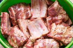 Raw marinated meat on bones. With spices Stock Photo