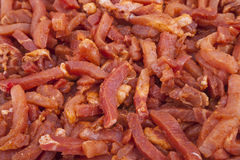 Raw, marinated meat strips Royalty Free Stock Photos