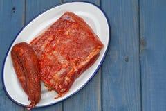 Raw marinated pork with chourico Royalty Free Stock Photography
