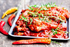 Raw  marinated  pork ribs on metal tray. Ready for BBQ Royalty Free Stock Images