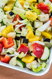 Raw marinated vegetables on a baking tray Royalty Free Stock Image