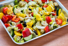 Raw marinated vegetables on a baking tray. Ready for roasting, selective focus stock photography