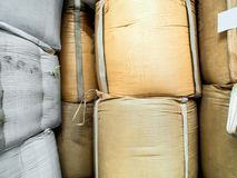 Raw material in the big woven plastic bag Royalty Free Stock Images