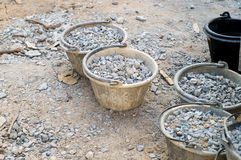 Raw material for construction. Stone and pail royalty free stock image