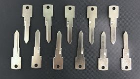 Raw materials key. Close up the raw materials used for making the key are placed on a black plastic box stock photos