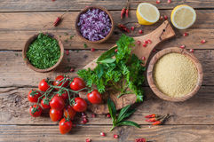 Raw materials for tabbouleh salad on rustic wooden table. Raw materials for tabbouleh salad, a traditional Lebanese food royalty free stock images