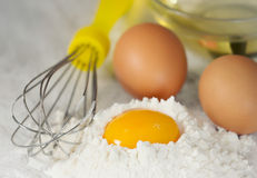 Raw mayonnaise or pancakes ingredients.Eggs with flour and oil. Stock Photos