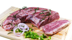 Raw meat. Cuts of fresh meat in white backgroun Stock Photos