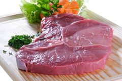 Raw meat. Cuts of freas meat in white backgroun Stock Photos