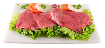 Raw meat. Meat fillet with vegetables on cutting board Royalty Free Stock Photography