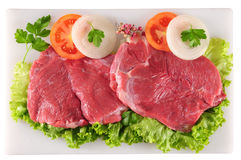 Raw meat. Meat fillet with vegetables on cutting board Royalty Free Stock Photo