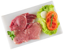 Raw meat. Meat fillet with vegetables on cutting board Stock Images