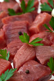 Raw meat. Food series: cube sliced raw meat with parsley Royalty Free Stock Image