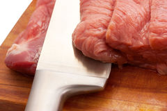 Raw meat. Slices of fresh raw meat on a cutting board Stock Photos
