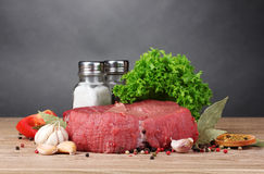 Raw meat. Vegetables and spices on gray background Royalty Free Stock Images