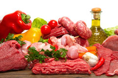 Raw meat. Fresh butcher cut meat assortment garnished Royalty Free Stock Image