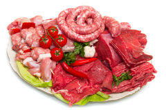 Raw meat. Fresh butcher cut meat assortment garnished Stock Images