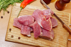 Raw meat. On wooden board Stock Images