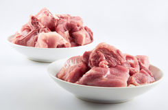 Raw Meat. Two plate of raw meat on clean background Stock Photo