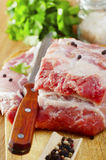 Raw meat. On wooden board Royalty Free Stock Photos